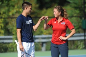 Courtesy of Duquesne Athletics | Junior Andrew Ong and Director of Tennis Vanessa Steiner share a fist bump during fall practice as they look to solidify the men's tennis team.
