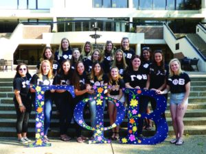 Courtesy of Gamma Phi Beta A group of Gamma Phi Beta members poses outside of the Student Union last semester.