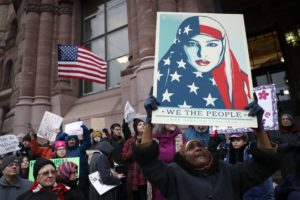 AP Photo  Demonstrators chant against President Donald Trump's executive order on Jan. 30, 2017, outside City Hall in Cincinnati. Duquesne students discussed the order.