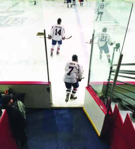 Adam Lindner   Asst. Sports Editor   Senior defensemen Zak Kindya and Michael Iannello along with junior forward Thomas Diffendal take the ice for the semifinal matchup against the John Carroll Blue Streaks on Saturday Feb. 25 at RMU's facility.