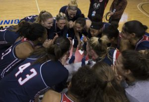 Courtesy of Duquesne Athletics | The Dukes huddle up at center court in the Richmond Coliseum as they took on the Saint Joseph's Hawks in the Atlantic 10 semifinals. The Dukes defeated the Hawks 78-63 on March 4 to advance to the tournament final.