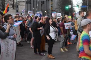 Zachary Landau | Asst. A&E Editor Protestors gathered in front of the City-County Building in Downtown Pittsburgh Feb. 22 to voice support for the transgender community and transgender youth.