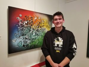 Sean Armstrong/Staff Writer Pitt graduate Cameron Schmidt poses with his one of his street art-inspired works.